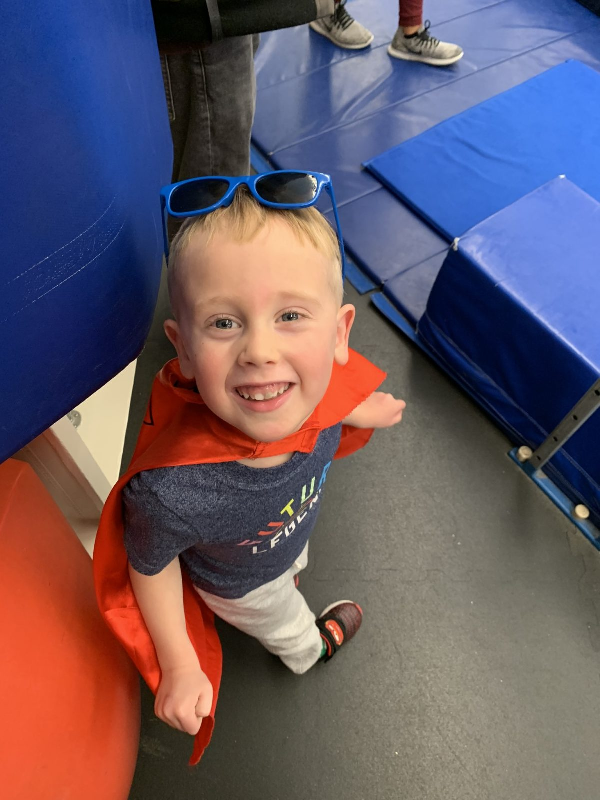 Superman watching Ellie at gymnastics